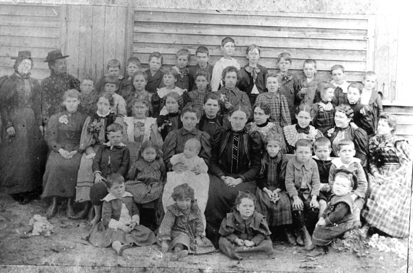 Oak School, Lizzie Todd, teacher: 1st row: Irby Terrell, Sallie Lee, Ruth Terrell, Carl Terrell 2nd row: Henry Todd, Ruby Lee, Mrs. W. J. Lee and Tom, Miss Lizzie Todd, Mable Kidd, Powell Lee, Olin Todd, Wilson Bell. 3rd. row: Unknown girl, Nannie Todd, 2 Unknown girls, Luke Terrell, Bertha Todd, Edna Huie (Amos Daniel Humphries' step daughter), Mattie Lee (who married Chester Jones). 4th row: Unknown boy, Lennie Wayne, Dannie Wesley, 2 Unknown girls, Lily Mitchell, Unknown girl, Exa Huie (another ADH stepdaughter), Annie Terrell. 5th row: Beulah Jones, Unknown girl, Lorrell Terrell, Lewis Kidd, Raymond Terrell, Griffin Dunn, Quigg Terrell, John Wayne, Rove Green, George Todd, Jim Lee, Henry Wesley, Will Kidd